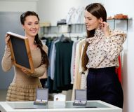 Woman and shop assistant choosing jewellery Royalty Free Stock Image