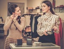 Woman and shop assistant choosing jewellery Royalty Free Stock Photography