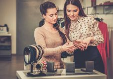 Woman and shop assistant choosing jewellery Stock Photography