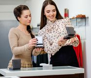 Woman and shop assistant choosing jewellery royalty free stock photo