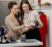 Woman and shop assistant choosing jewellery Stock Image
