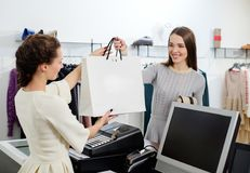 Woman and shop assistant  in a showroom Stock Image