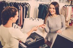 Woman and shop assistant in a showroom Stock Photography