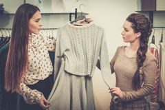 Woman and shop assistant in showroom Royalty Free Stock Photo