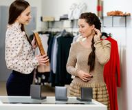 Woman and shop assistant in a showroom Royalty Free Stock Image