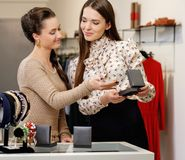 Woman and shop assistant in a showroom Royalty Free Stock Images