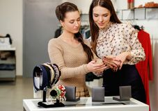 Woman and shop assistant in a showroom Royalty Free Stock Photo
