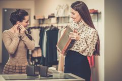 Woman and shop assistant in a showroom Stock Photos