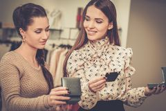 Woman and shop assistant in a showroom Stock Images