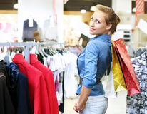 Woman in a shop buying clothes Stock Image