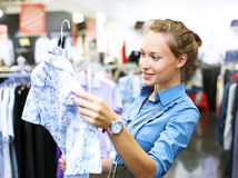 Woman in a shop buying clothes Royalty Free Stock Photo