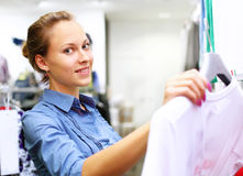 Woman in a shop buying clothes Royalty Free Stock Photos