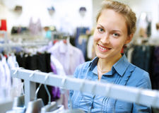 Woman in a shop buying clothes Stock Images