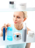 Woman in shop chooses cosmetics . Stock Photography