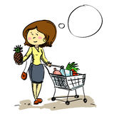 Woman in shop chooses fruit Royalty Free Stock Image
