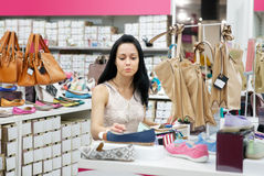 Woman in shop Stock Photography
