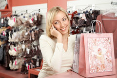 The woman shop and a mobile phone Stock Photo
