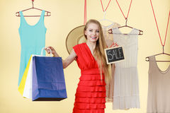 Woman in shop picking clothes, sale concept Stock Photography