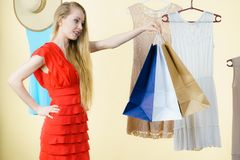 Woman in shop picking summer outfit Stock Images
