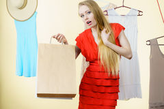 Woman in shop picking summer outfit Stock Photography