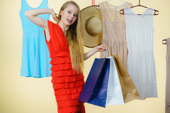 Woman in shop picking summer outfit Royalty Free Stock Image
