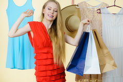 Woman in shop picking summer outfit Royalty Free Stock Photography