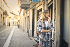 Woman and shop window Stock Image