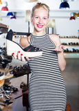 Woman shopaholic holding desired shoe Stock Photos