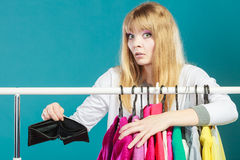 Woman with shopaholic problems. Royalty Free Stock Image