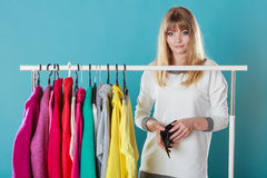 Woman with shopaholic problems. Royalty Free Stock Images