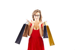Woman on shoping. In red dress Royalty Free Stock Images