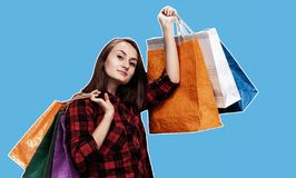 Woman with shoping bags. Ð¡ommerce and shopping season. Happy young woman with shoping bags. Magazine style collage with copy space royalty free stock photo