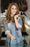 Woman shoping in a cloth shop stock image