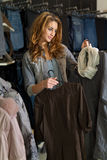 Woman shoping in a cloth shop Royalty Free Stock Images