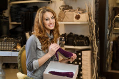 Woman shoping in a cloth shop Stock Images