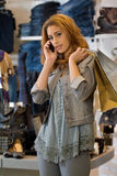 Woman shoping in a cloth shop royalty free stock image