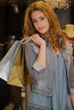 Woman shoping in a cloth shop Royalty Free Stock Photography