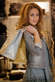 Woman shoping in a cloth shop royalty free stock photo