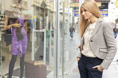 Woman in shoping street looking at window Stock Photos