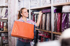 Woman shopper looking for beautiful bed linen Stock Images