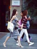 Woman shoppers walking on street