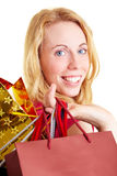 Woman shopping. Happy woman with a lot of colorful shopping bags royalty free stock photography