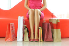 Woman shopping. Woman with bags in shopping mall Stock Image