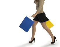 Woman shopping. Waist-down view of woman carrying shopping bags Royalty Free Stock Image
