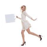 Woman shopping. Haoppy woman shopper holding shopping bag Royalty Free Stock Photography