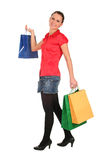 Woman Shopping. Happy woman with shopping bags Royalty Free Stock Photo