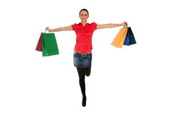 Woman Shopping. Happy woman with shopping bags Stock Photos