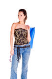 Woman Shopping. Mid adult woman in a black and gold corset and blue jeans  holding a large shopping bag Royalty Free Stock Photo