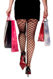 Woman in shopping. Woman's leg and high heel shoes Stock Photo