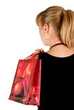 Woman in shopping. Girl in black holding shopping bags Stock Photography